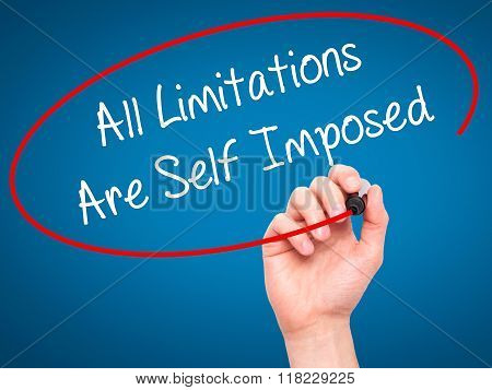 Man Hand Writing All Limitations Are Self Imposed With Black Marker On Visual Screen