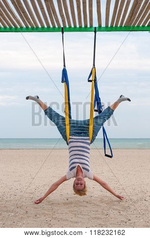Young women doing aerial yoga asanas or antigravity Yoga indoor. Flying, fitness, stretch, balance,