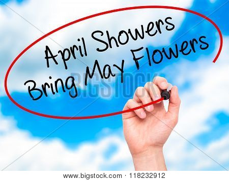 Man Hand Writing April Showers Bring May Flowers With Black Marker On Visual Screen
