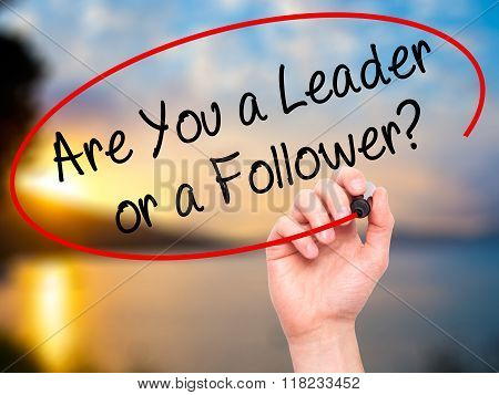 Man Hand Writing Are You A Leader Or A Follower? With Black Marker On Visual Screen