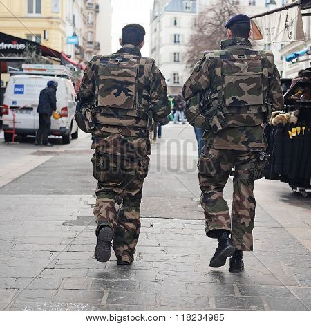 Paris, France, February 9, 2016: millitary patrol on a street in a center of Paris, France.