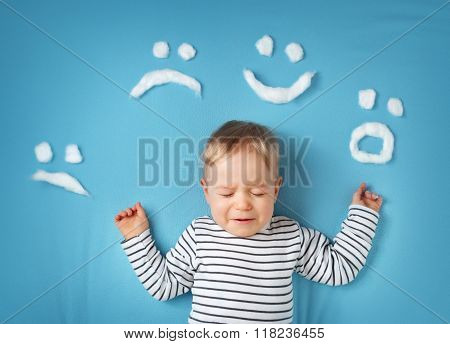little boy on blue blanket background