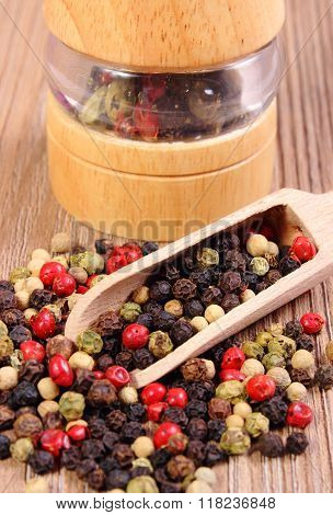 Pepper With Spoon And Mill On Wooden Background