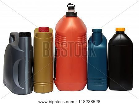Plastic bottles from automobile oils isolated on white background