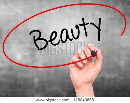 Man Hand Writing Beauty  With Black Marker On Visual Screen
