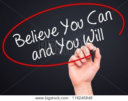 Man Hand Writing Believe You Can And You Will With Black Marker On Visual Screen
