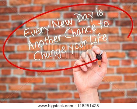 Man Hand Writing Every New Day Is Another Chance To Change Your Life With Black Marker On Visual Scr