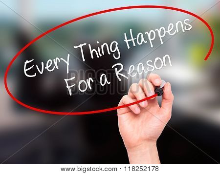 Man Hand Writing Every Thing Happens For A Reason With Black Marker On Visual Screen