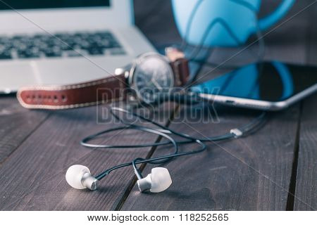 Headphones On Wooden Table