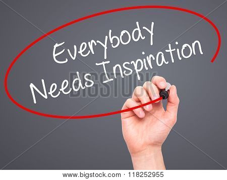 Man Hand Writing Everybody Needs Inspiration With Black Marker On Visual Screen