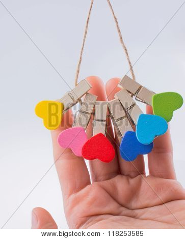 Colorful hearts on clothtes pin