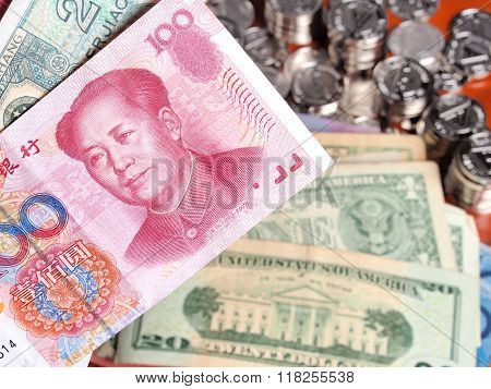 Chinese Yuan Note In Front Of Us Dollar Notes