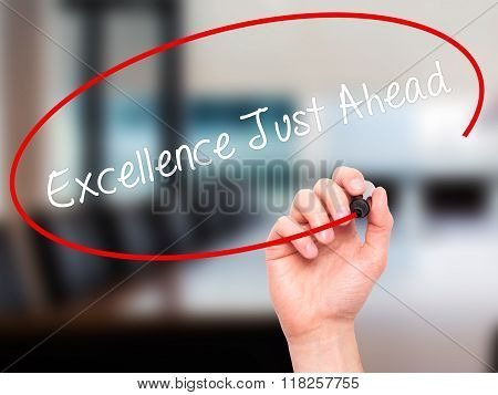 Man Hand Writing Excellence Just Ahead With Black Marker On Visual Screen
