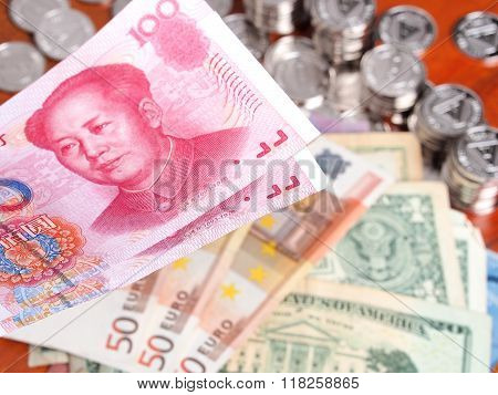 Chinese Yuan Note In Front Of  Euro And Us Dollar Notes.