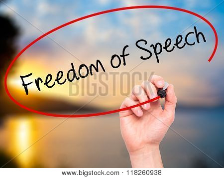 Man Hand Writing Freedom Of Speech With Black Marker On Visual Screen