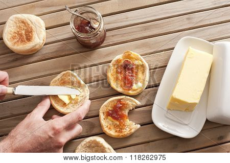 Man Buttering A Fresh Crumpet For Breakfast