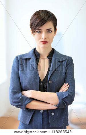 Portrait Of Young Beautiful Business Woman. Crossed Arms