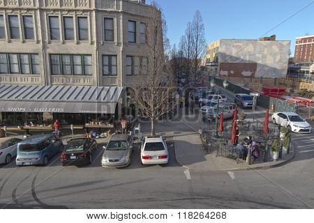 Asheville North Carolina USA - January 30 2016: View overlooking part of downtown Asheville at the corner of Battery Park and Page Avenue withstreet vendors people relaxing and strolling along the street and construction nearby