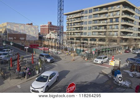 Asheville North Carolina USA - January 30 2016: View overlooking part of downtown Asheville at the corner of Battery Park and Page Avenue with people relaxing and strolling along the street amid continuing construction