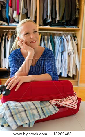 woman while packing your suitcase for vacation