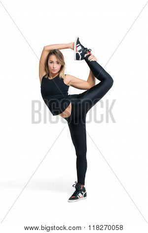 Young Woman Doing Standing Split Isolated