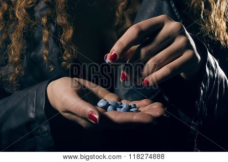 Drug Abuse. Woman With Pills In Hand Taking One.