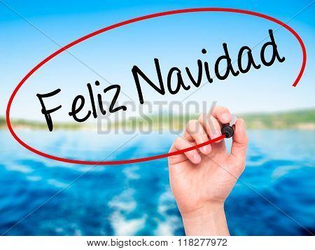 Man Hand Writing Feliz Navidad  (merry Christmas In Spanish) With Black Marker On Visual Screen