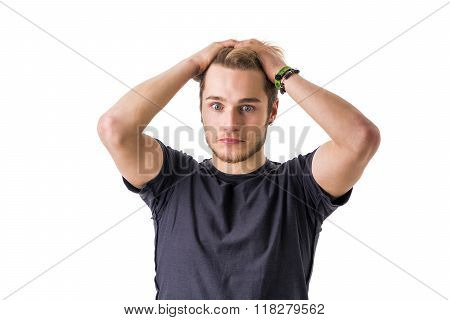 Young bearded man confused and shocked