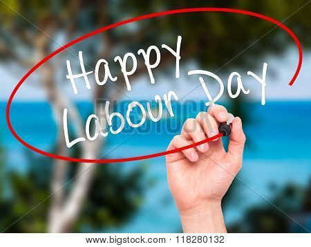 Man Hand Writing Happy Labor Day With Black Marker On Visual Screen