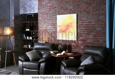 Modern living room interior with leather armchairs