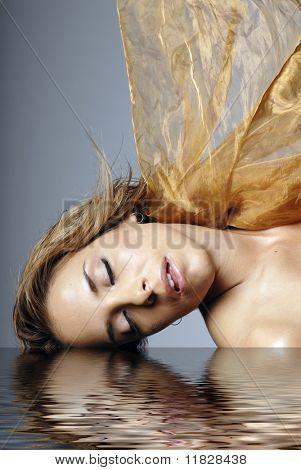 Sexy Hispanic girl in spa water