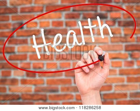 Man Hand Writing Health With Black Marker On Visual Screen