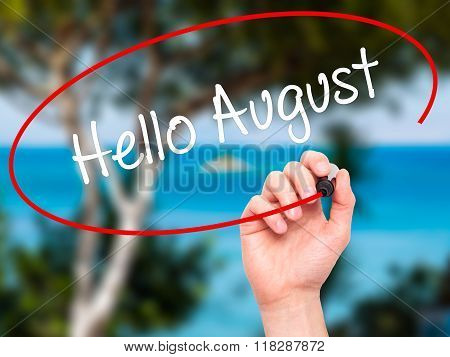 Man Hand Writing Hello August With Black Marker On Visual Screen