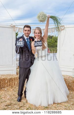 bride and groom newly married at wedding reception. ,