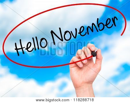 Man Hand Writing Hello November With Black Marker On Visual Screen