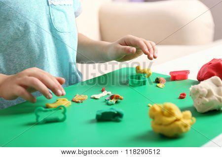 Child sculpts from plasticine, closeup