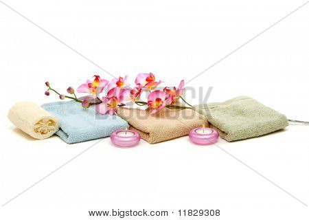 Spa towels, candles and orchid