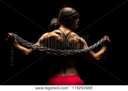 Woman In Sports Bra And Shorts Chain Across Back From Back Highlighted