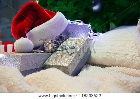 Christmas gift boxes, pillow and hat on the soft carpet, indoor