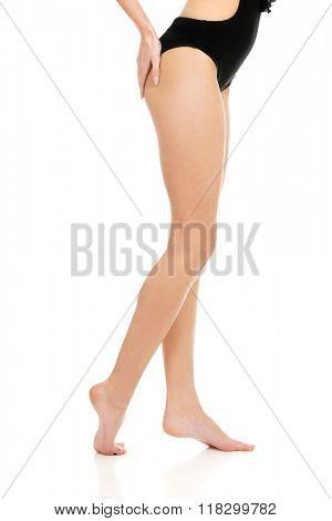 Woman's legs in swimsuit.