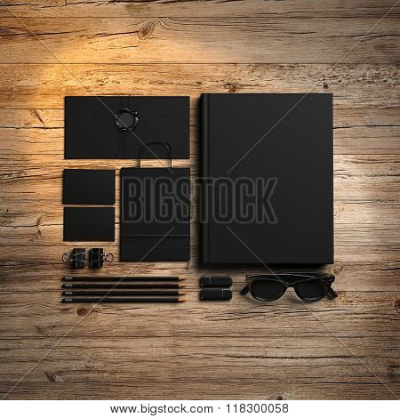 Set of branding elements on the wood background.  3d render