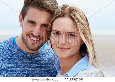 Head And Shoulders Portrait Of Couple On Beach