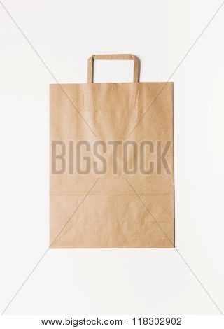 Craft shopping bag isolated on white background. Vertical