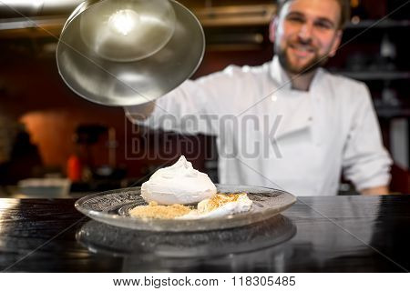 Chef cook serving dessert to the client