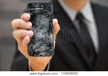 Businessman Showing Broken Smartphone With Crashed Screen