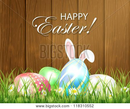 Wooden Easter Background With Multicolored Eggs And Rabbit