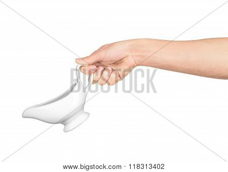 Hand Holds White Gravy Boat Isolated On White Background