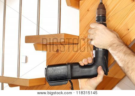 Power Screwdriver Is Fixing Stairs