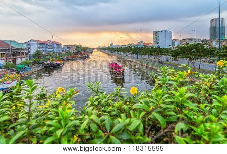 Close up flower boat on river suftwaves rays sunset