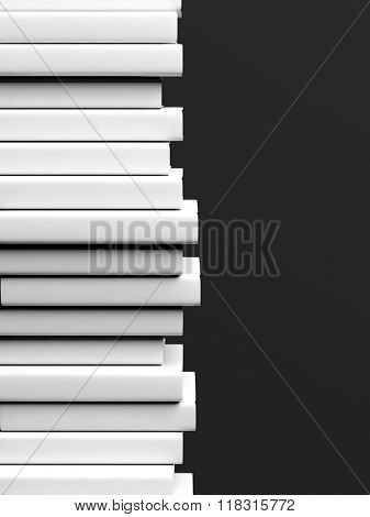 Stack of books with blank hardcover, isolated on black background.